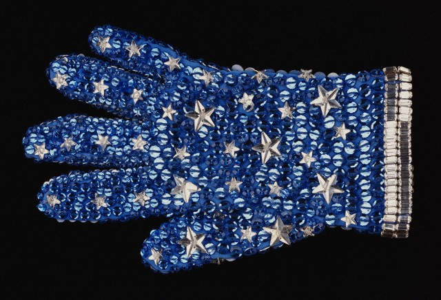 A rhinestone stage glove of sky blue cotton stockinette encrusted with sparkling rhinestones, as worn by Michael Jackson in the 1988 video, Moonwalker